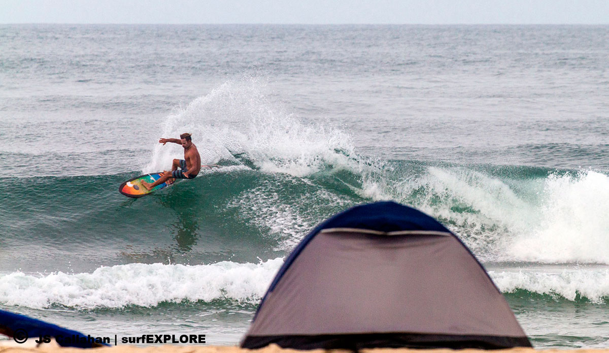 """Emiliano Cataldi carves over the tent in the Turtle Islands on his new quad, with a bottom hull design adapted from George Greenough\'s spoon kneeboards. Photo: <a href=\""""http://surfexplore.info/\"""">surfEXPLORE</a>/John Seaton Callahan"""