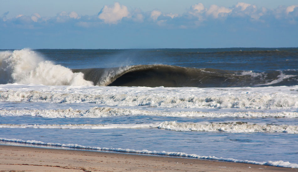"The Outer Banks is an amazing place. You can pull off and possibly find world class waves at any turn. It's so wide open and constantly changing. This is a random north swell hitting a random sandbar on the side of the road.  Photo: <a href=""http://thewildlyfe.com/\"">Eddie Compo/TheWildLyfe</a>"
