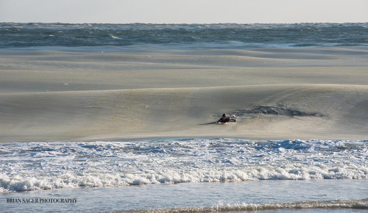 "Mark Latter, sliding into a slushy one. Photo: <a href=\""http://www.briansagerphotography.com\"">Brian Sager</a>"