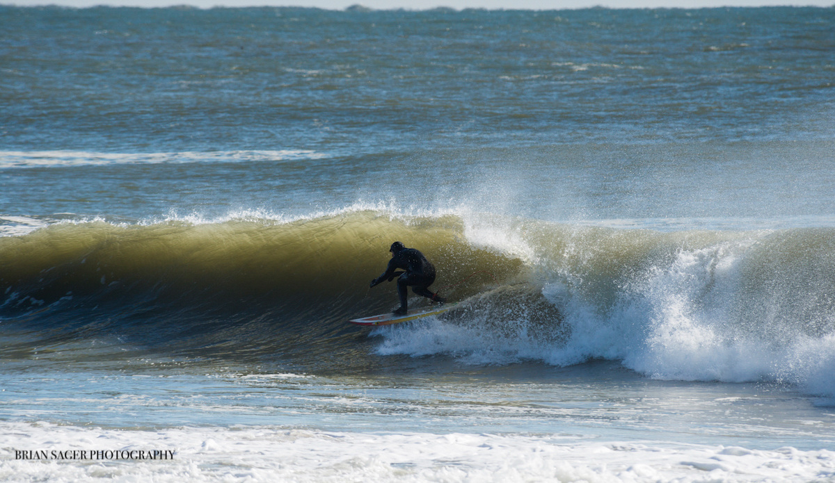 """Local surfer Mark Latter, tucked in on a runner. Photo: <a href=\""""http://www.briansagerphotography.com\"""">Brian Sager</a>"""