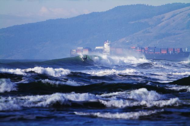 A tanker ship passes by a surfer at Ocean Beach.  Photo: Seth Migdail/SFGate.com