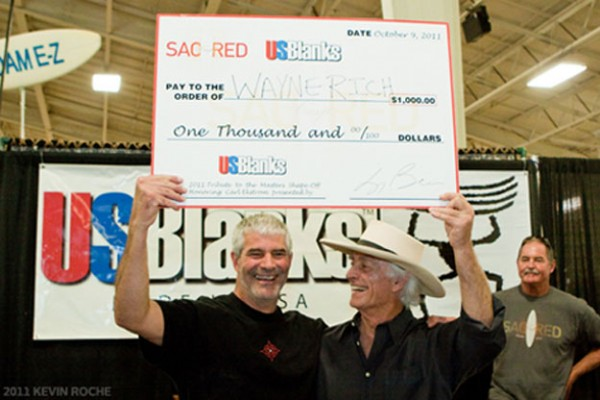 Wayne Rich looking happy with an over-sized cheque. Photo: Roche