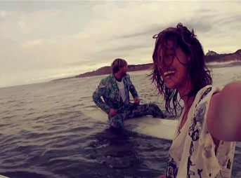 Kassia Meador and Mikey Detemple longboard Montauk and say goodbye to summer.