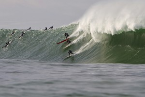 Party wave at Mavericks 2010. Todd Tissue, Ryan Augenstein and Tyler Fox