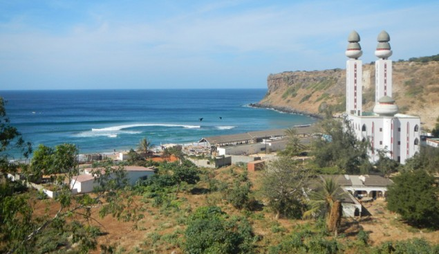 A large Mosque overlooks a traditional fishing village and one of the best waves in Dakar. Image: Persaud