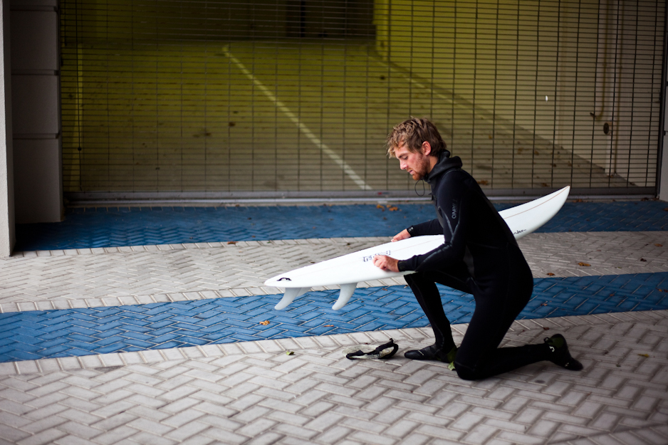 Waxing the surfboard: the grandaddy of all surf rituals. Tyler Vaughan demonstrates. Photo: Ryan Struck.