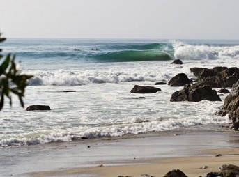 "Perfect barrels peel across ""Holy Shits"" in Oaxaca, Mexico. This is one of Rusty Long's favorite spots. Photo: Rusty Long"