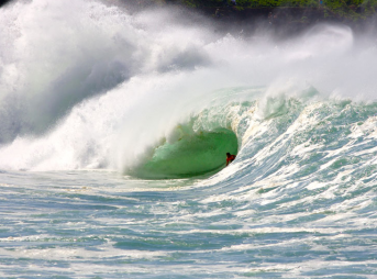 Andy Irons in Waimea shore break. Definitely qualifies as fuck you style. Photo: Tupat
