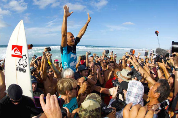 King Kelly gets chaired up the beach for lucky number seven at Pipe. Photo: Matt Dunbar
