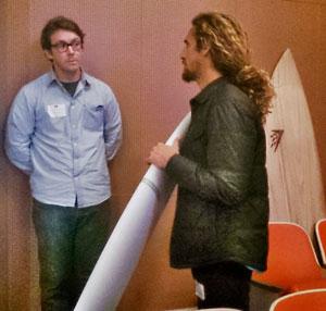 Falken shows a BIOM blank to Machado. A Timbertek rests on the wall.
