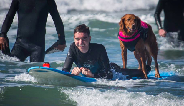 Caleb and Ricochet enjoying some rollers in San Diego. Photo: Dale Porter | Facebook: Surf Dog Ricochet
