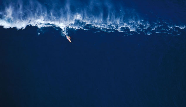 Garrett McNamara tow-surfing big waves at Outside Avalanche. Photo: Sean Davey
