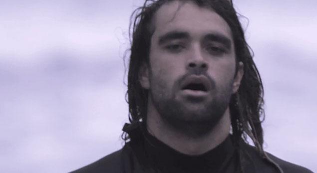 An Otis Carey still from Satan Surfs.  If Satan surfs as well as Otis, hell will be a great show.