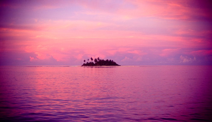 Purple sunset in the Mentawais, shot on velvia film. Sometimes you can put things in the center of the frame. Image: Roche