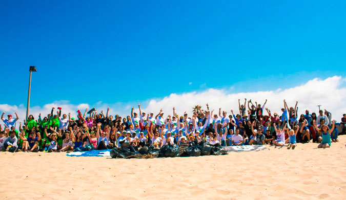 Volunteers cheering after a successful beach cleanup