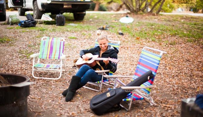 Lakey Peterson playing guitar.