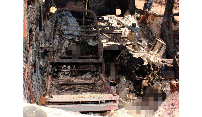 The inside of the torched van. The remains have been blurred. Picture: Noroeste.com/Carlos Chaidez