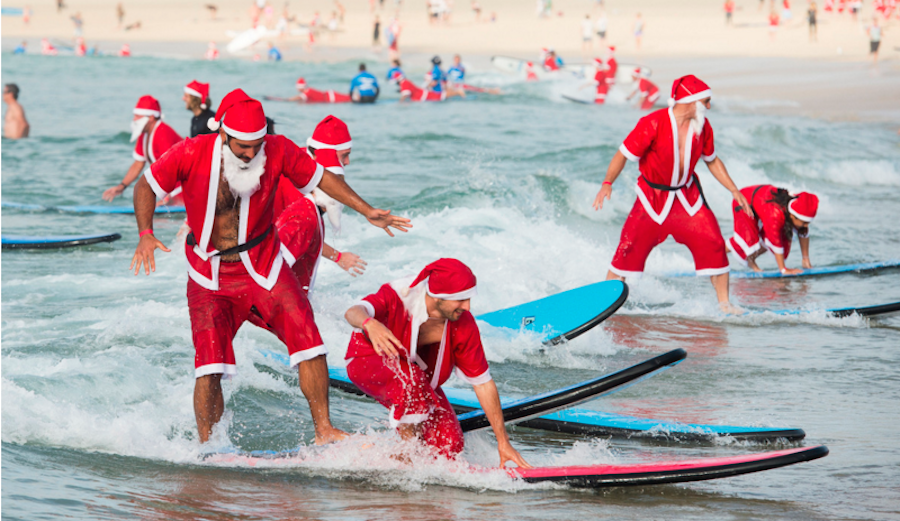 An army of surfing santas just descended on bondi beach the inertia 320 surfers flocked to bondi beach in australia last week all clad in santa claus suits malvernweather Gallery