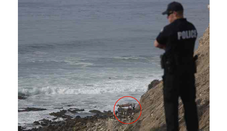 Police investigating the secret hideout of the Lunada Bay Boys last week. Photo: Chuck Bennett/Daily Breeze