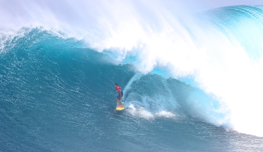 Albee Layer, pushing the limits in terms of big wave barrel-riding. Here he is standing tall in a Pe'ahi cavern. Credit: DoomaPhotos