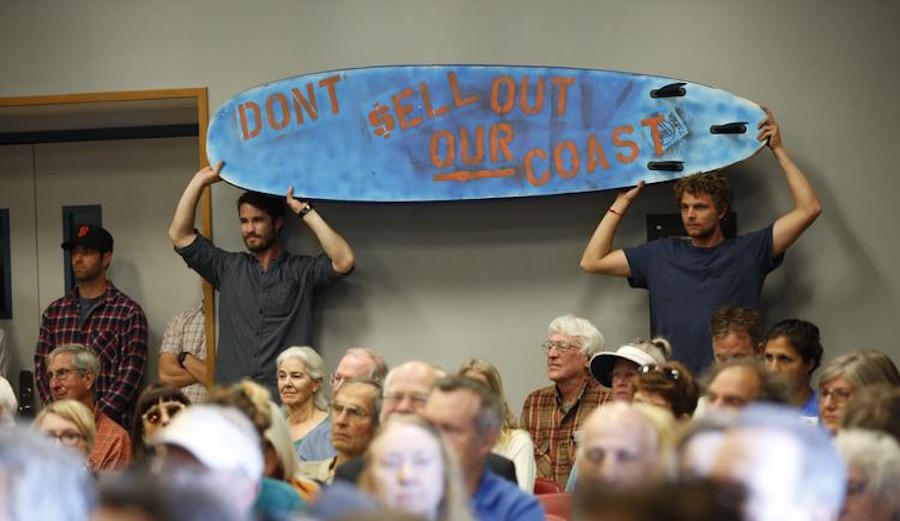 Alex Lowe, left, and Rob Moddlemog traveled all the way to Morro Bay from Orange County to support ousted California Coastal Commissioner Charles Lester, who was fired Wednesday amid a sea of controversy. (Photo:  Al Seib / Los Angeles Times)