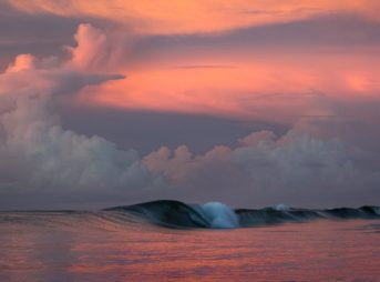 Beautiful glassy morning session under a colourful sunrise.  Upola. Samoa.