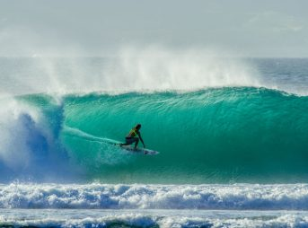 It's tough to imagine surfing massive Cloudbreak with two arms, let alone one. Photo: Aaron Lieber