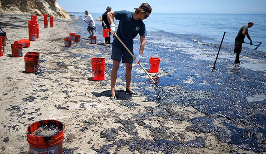 Volunteers help to clean up the devastation at Refugio State Beach in Santa Barbara. Photo: Lucy Nicholson