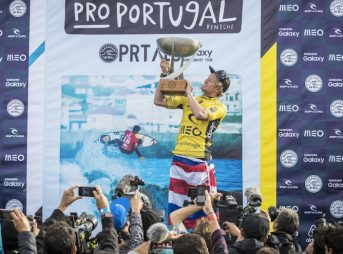John John raises the world title trophy in Portugal – the fourth Hawaiian ever to do so. Photo: WSL/Poullenot/Aquashot
