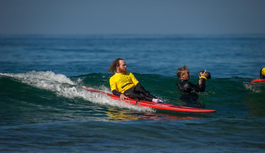 local clinic participant Mike Robbins-Waid gliding down the line. Photo: ISA/Sean Evans