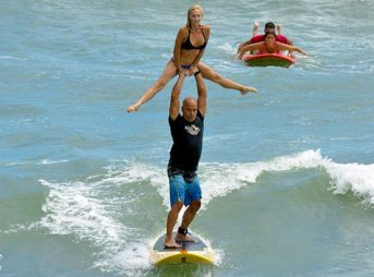 Ed Martinez and his wife tandem surfing and political champs. Photo: @tandemsurfing