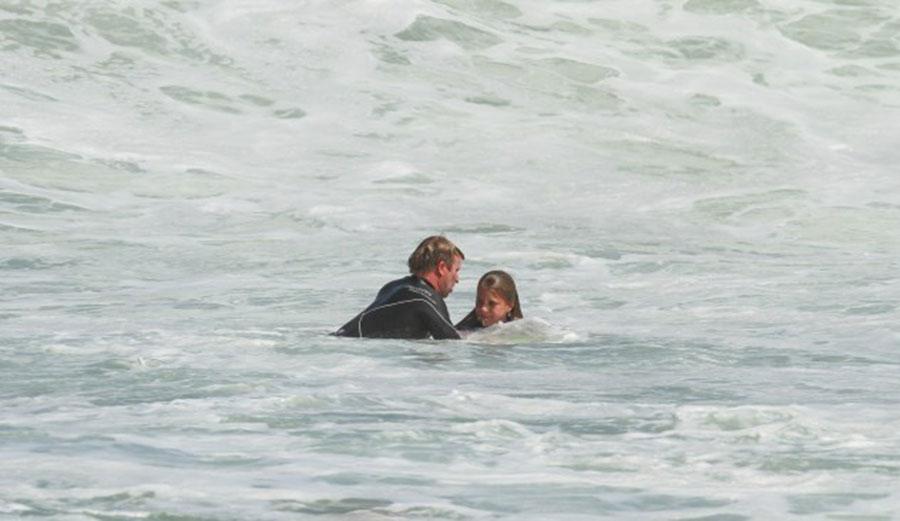 Taj, mid-rescue. Photo: Surfing WA/Nick Woolacott