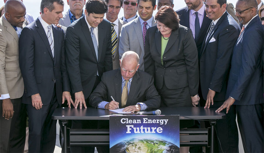 California Gov. Jerry Brown signs SB350 on Oct. 7, 2015. The bill calls for increasing the state's renewable electricity use to 50 percent and doubling energy efficiency in existing buildings by 2030. AP Photo/Damian Dovarganes
