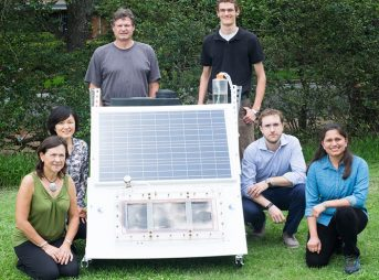 Rice University researchers (from left) Naomi Halas, Qilin Li, Peter Nordlander, Seth Pederson, Alessandro Alabastri and Pratiksha Dongare with a scaled up test bed of the NEWT Center's direct solar desalination system. (Photo by Jeff Fitlow/Rice University)