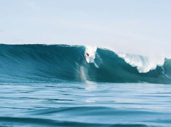 Matt Bromley is surfing a very large wave that was created after Indonesia's Boxing Day earthquake.