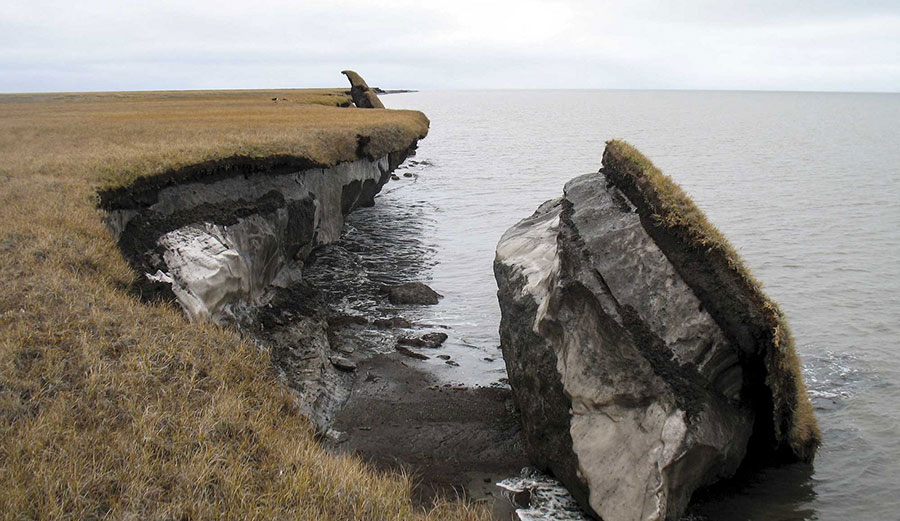 Collapsed block of ice-rich permafrost along Drew Point, Alaska, at the edge of the Beaufort Sea. Coastal bluffs in this region can erode 20 meters a year (around 65 feet).