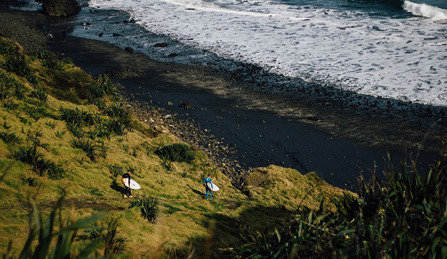 Surfers at Maori Bay, up the coast from the shootings.
