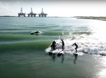 Jamie O'Brien Texas tanker waves with dolphins surfing