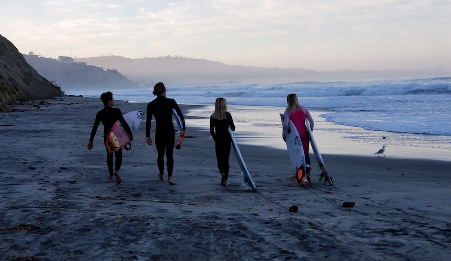 Caitlin Simmers, Kirra Pinkerton, Tanner Waite, and Lucas Owston surfing Blacks.