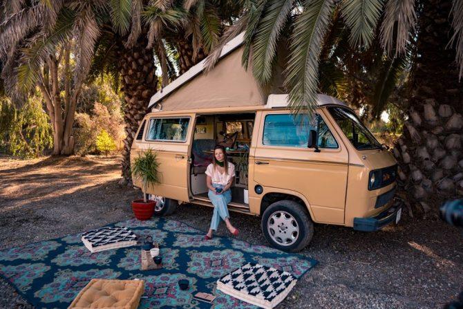 Stacie Vanags Salted Spirit Podcast Host in her Van