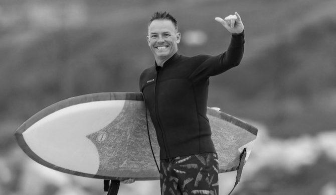 World Surf League CEO Erik Logan goes for a surf