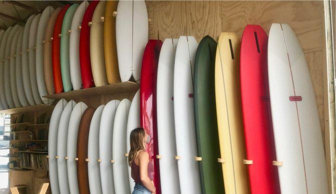 girl in surf shop
