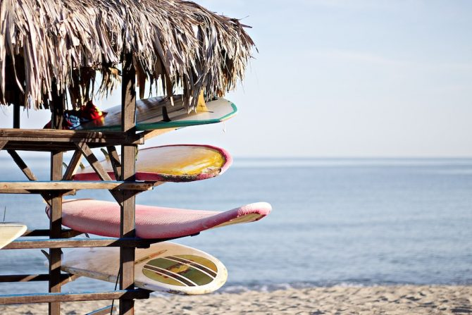 boards on a rack by the beach