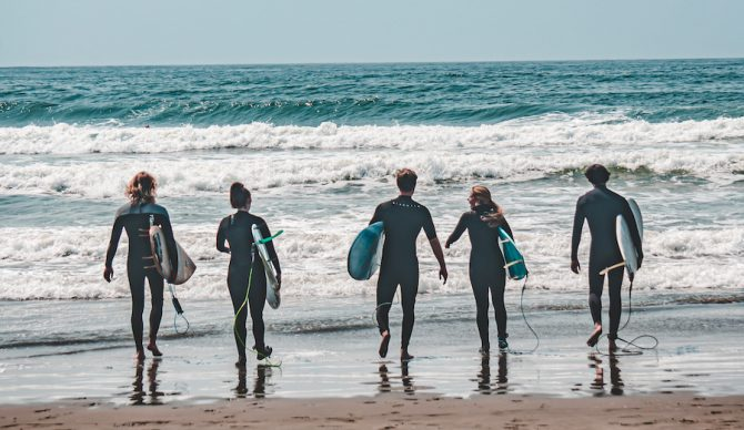 surfers walking into the ocean at Ocean Beach san francisco
