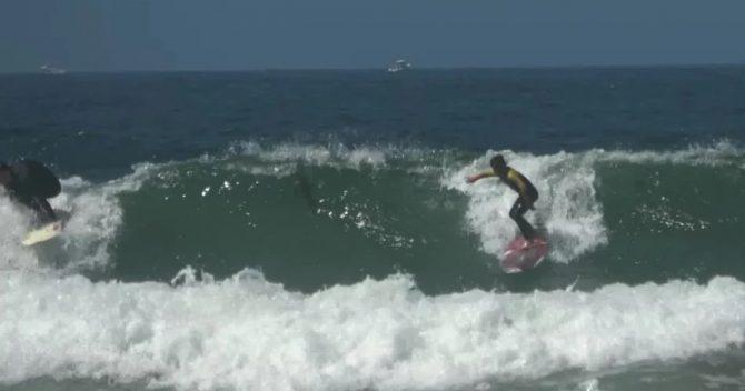jake coaching grom surfing